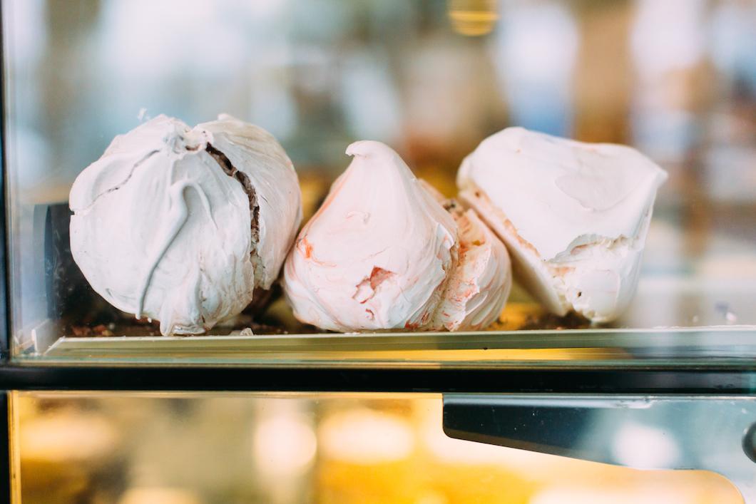 Large meringues at Papillon cafe, Northfields, Ealing