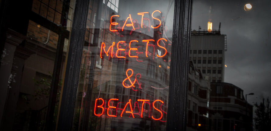 Eats, meets and Beats red neon sign, at the North Star pub, Ealing