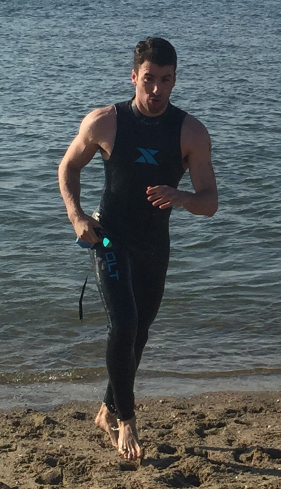 Ben Samit completes the swim portion of the 2016 Seaside Triathlon