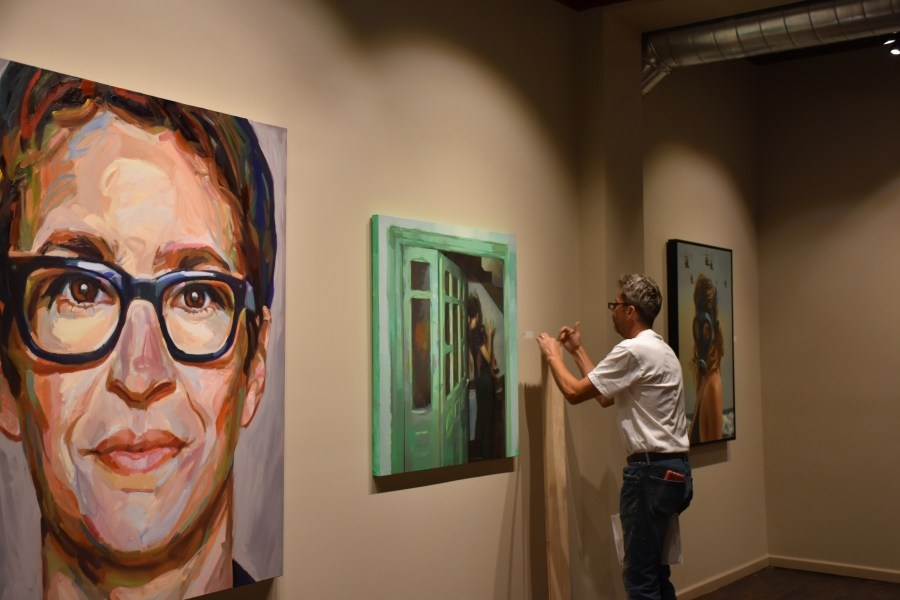 DAVID HUMMER, EXECUTIVE DIRECTOR OF WMOCA, PUTS THE FINISHING TOUCHES ON A NEW EXHIBITION SLATED TO OPEN THIS WEEK IN WAUSAU. (CREDIT: SHEREEN SIEWERT/WAUSAU PILOT & REVIEW)