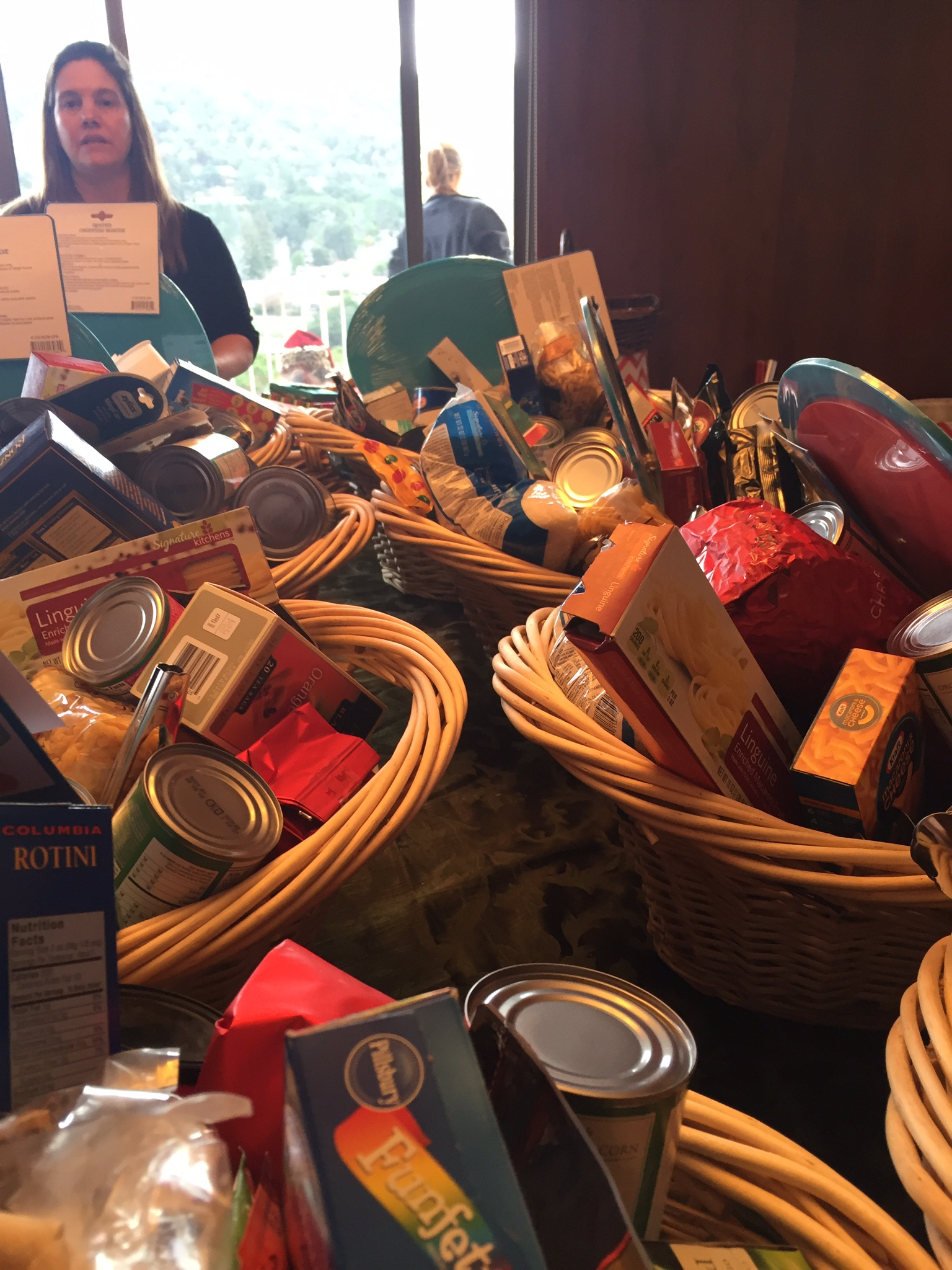 Each family receives a basket of non-perishable food, toiletries and other essentials