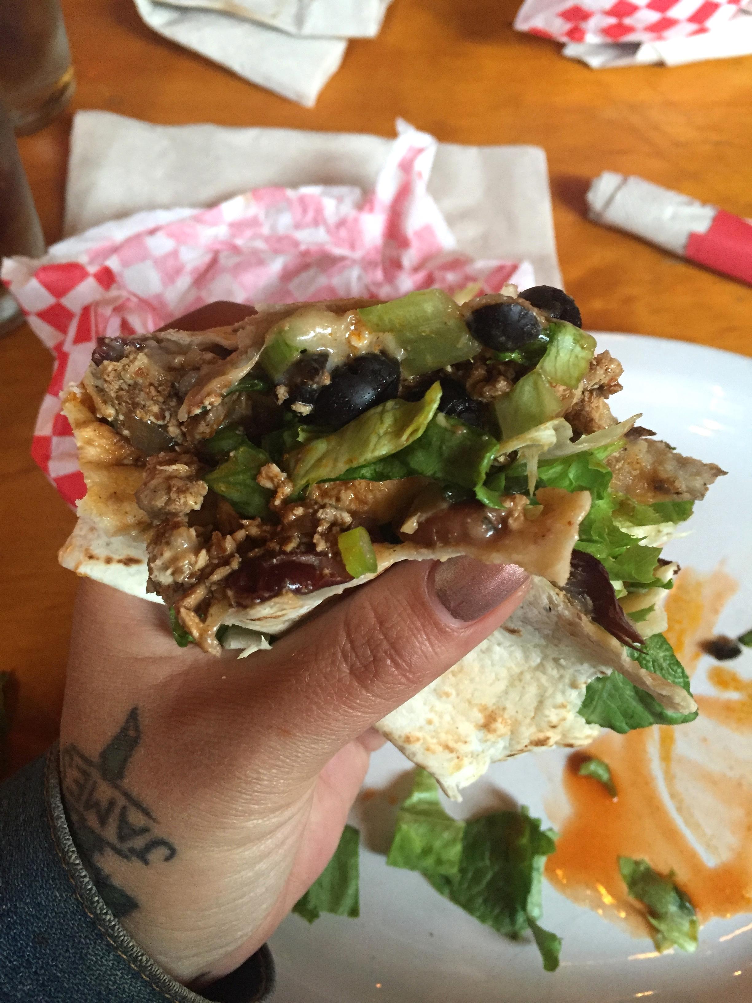 Half eaten down home burrito