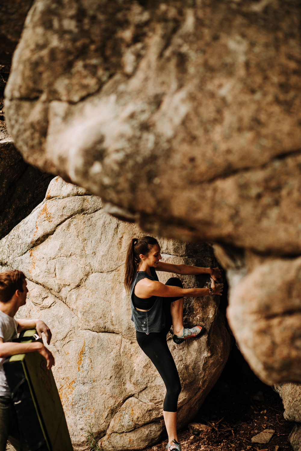 Woman beginning to boulder and rock climb