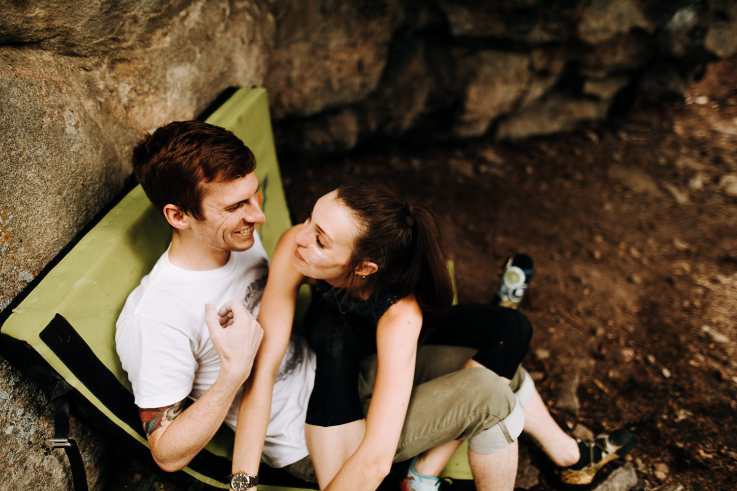 rock climbing adventure couple covered in chalk