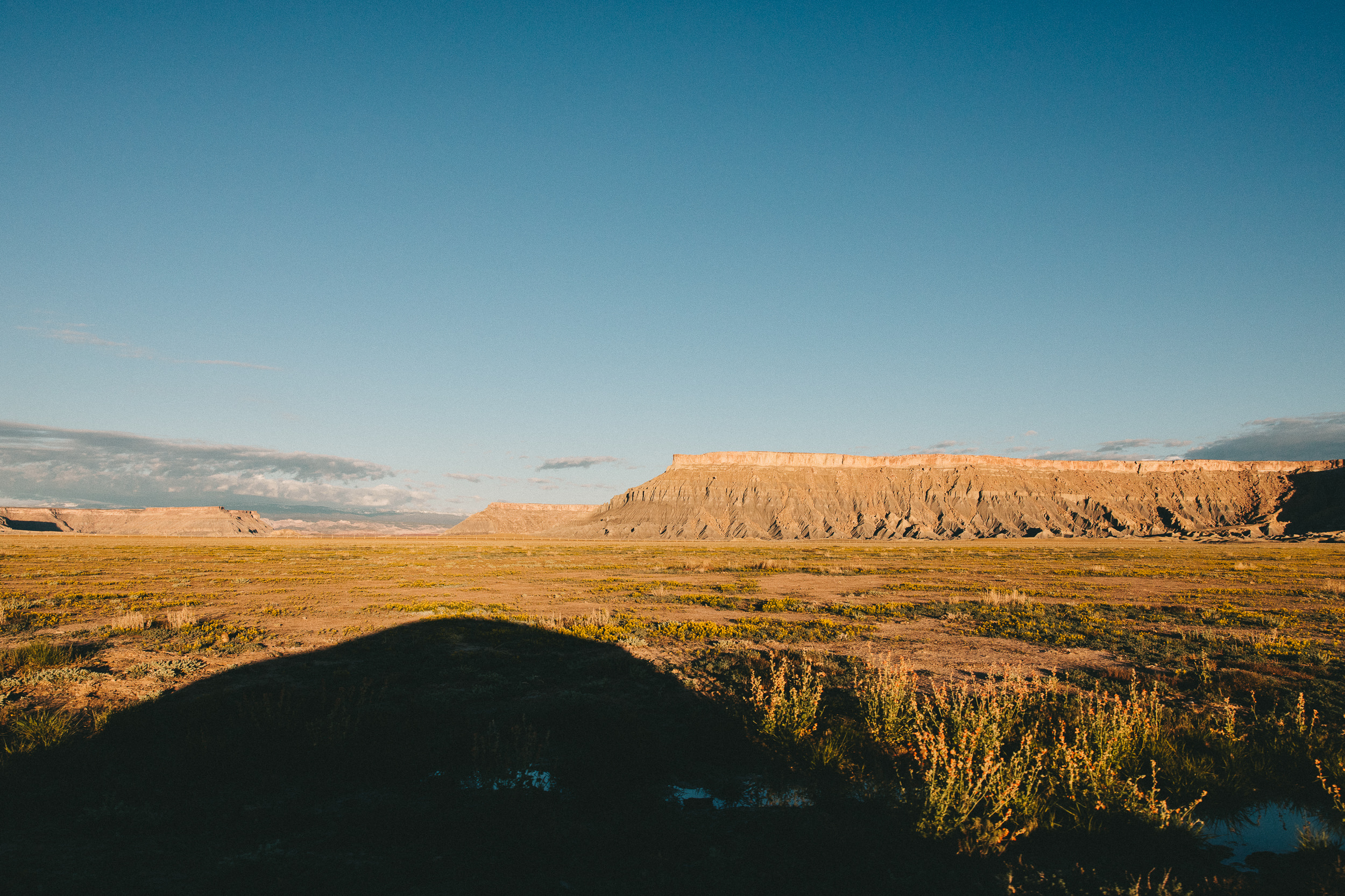 Driving out during sunrise of Factory Butte BLM area