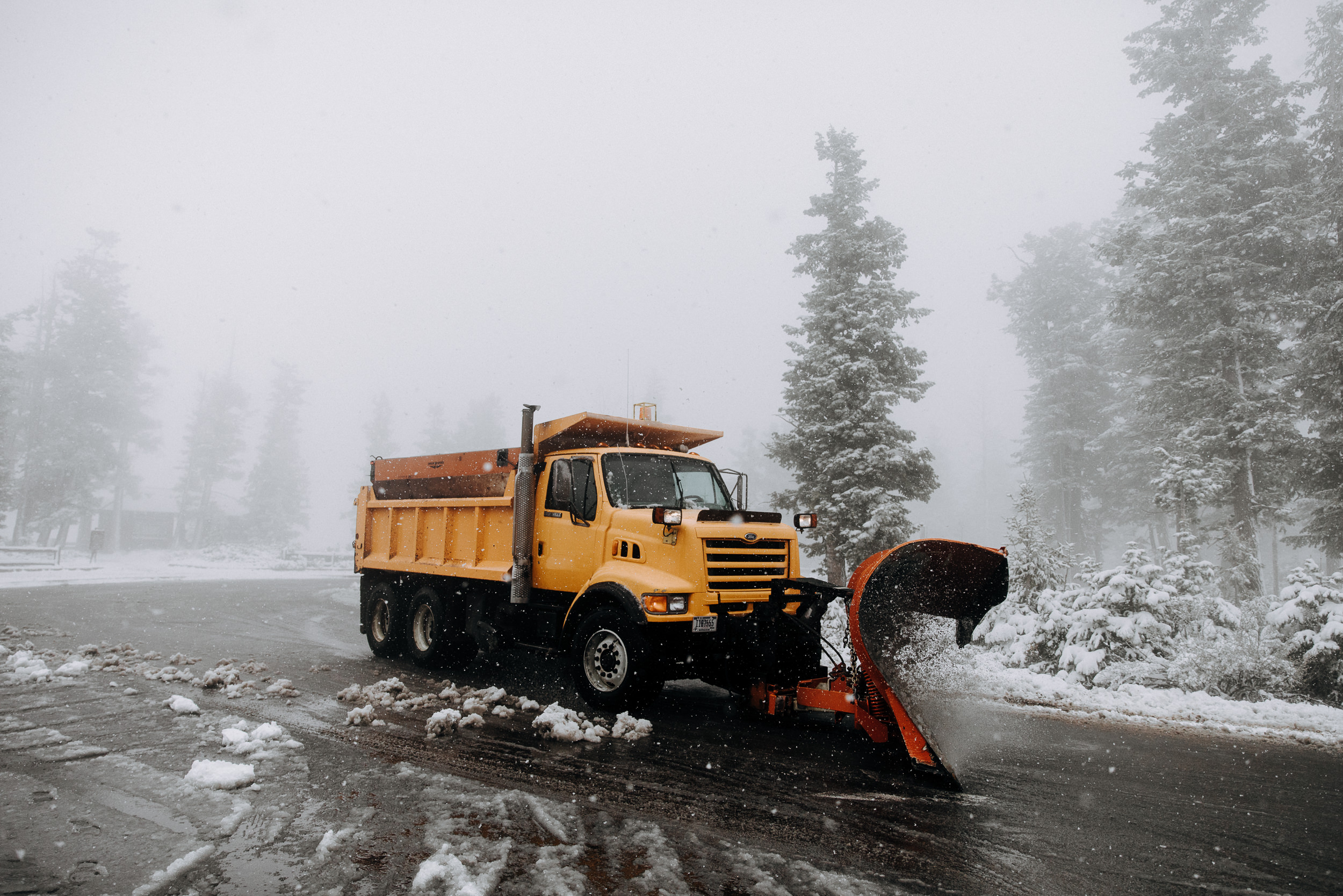 Bryce Canyon National Park covered in snow and fog - snow plow at Rainbow Point