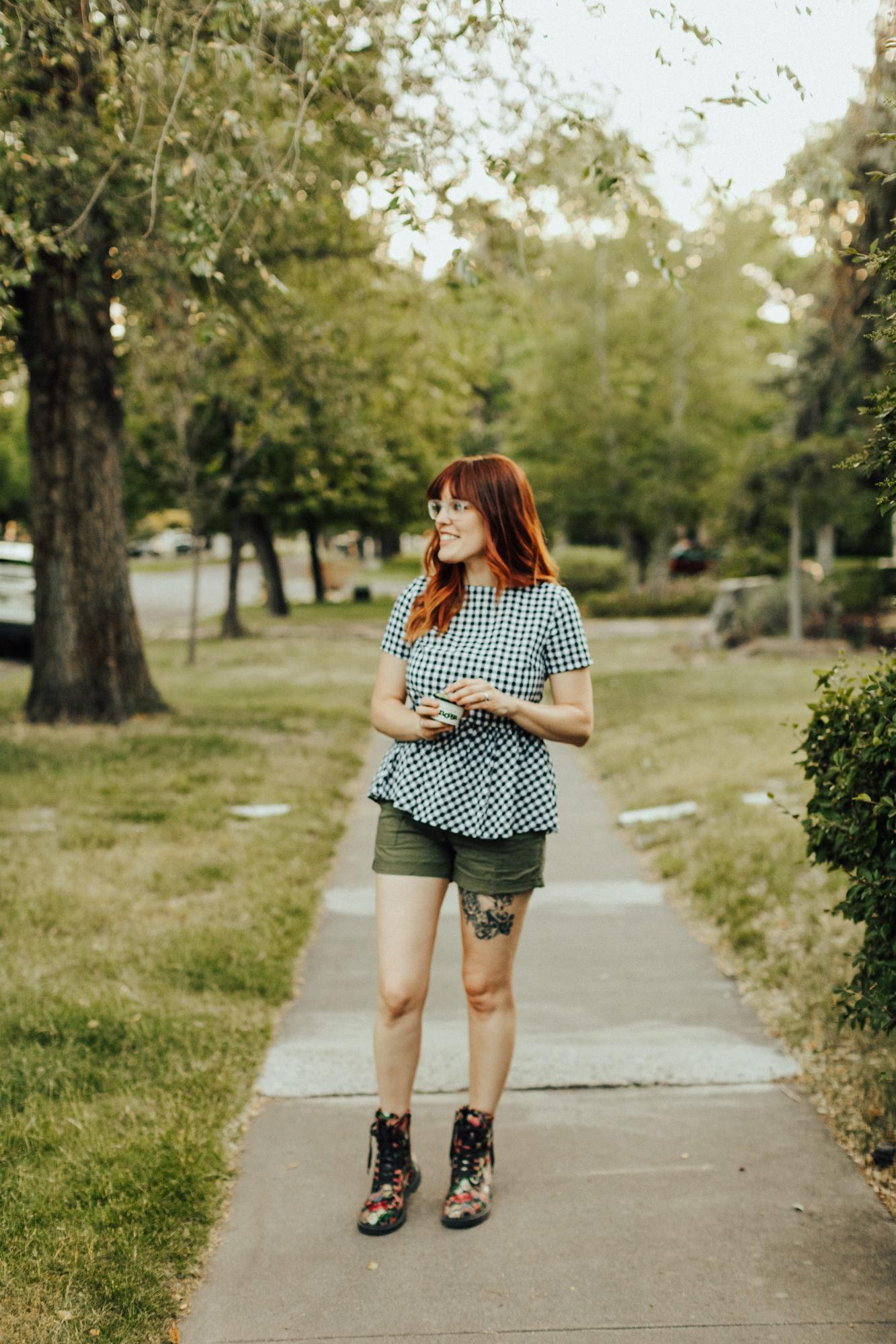 Woman walking down street eating Noosa yoghurt