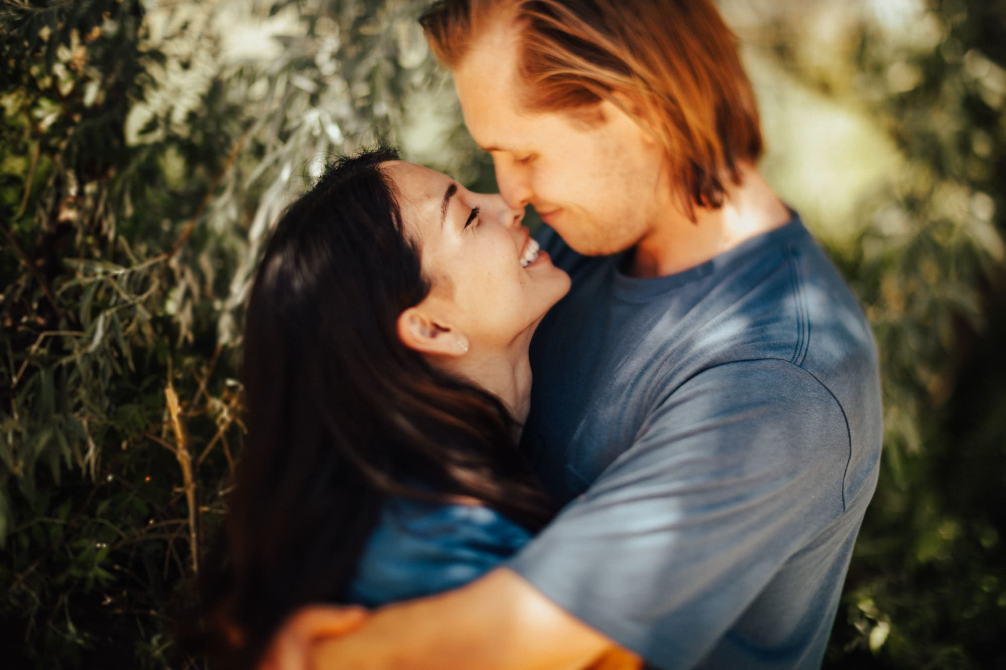 Couple smiling together for intimate outdoor photoshoot