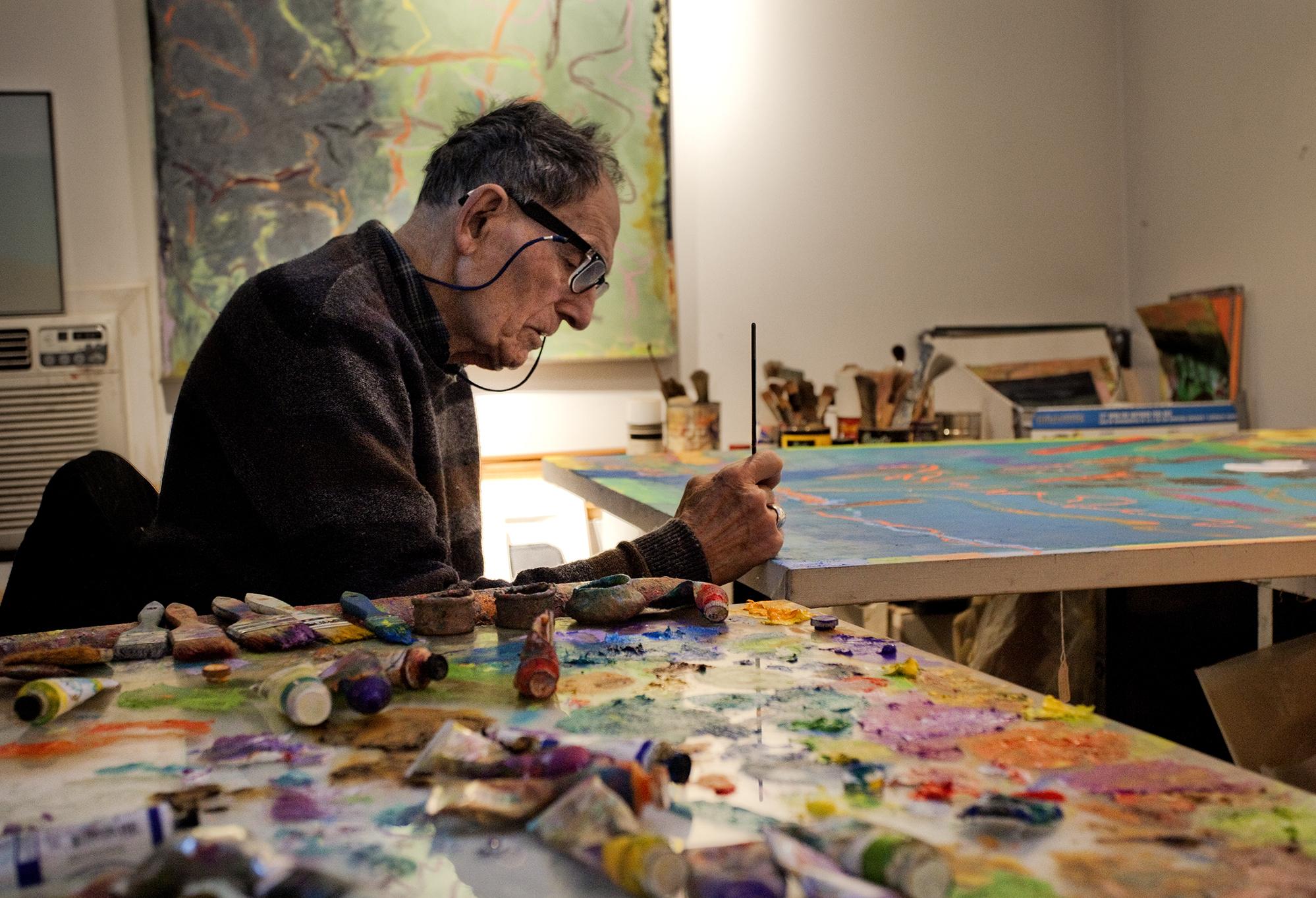 Stan Brodsky signing his work.jpeg