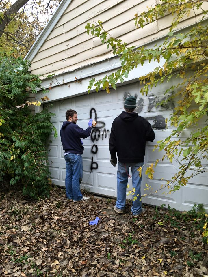 Cleaning up graffiti in our neighborhood.