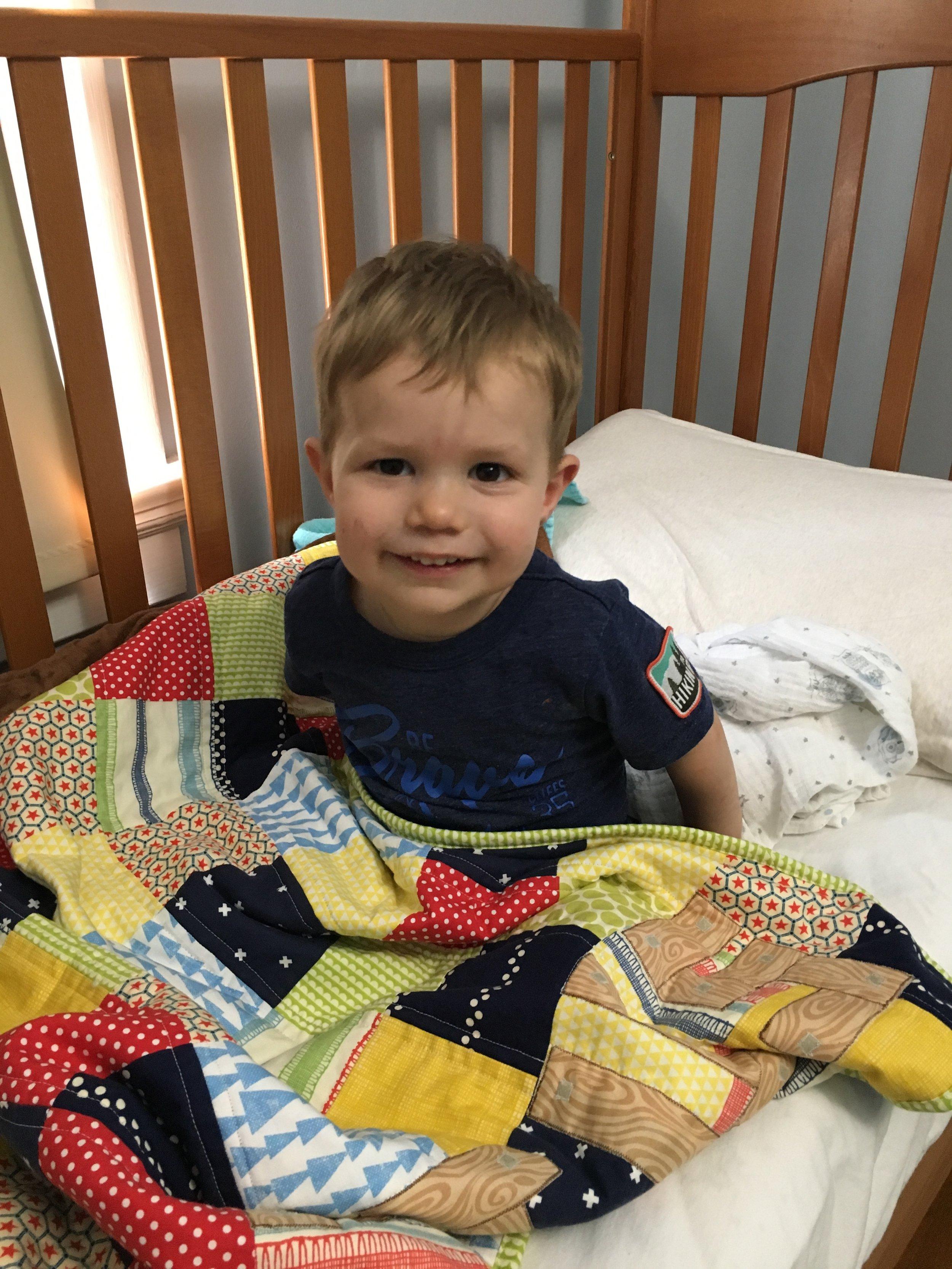 Titus in his big boy bed!