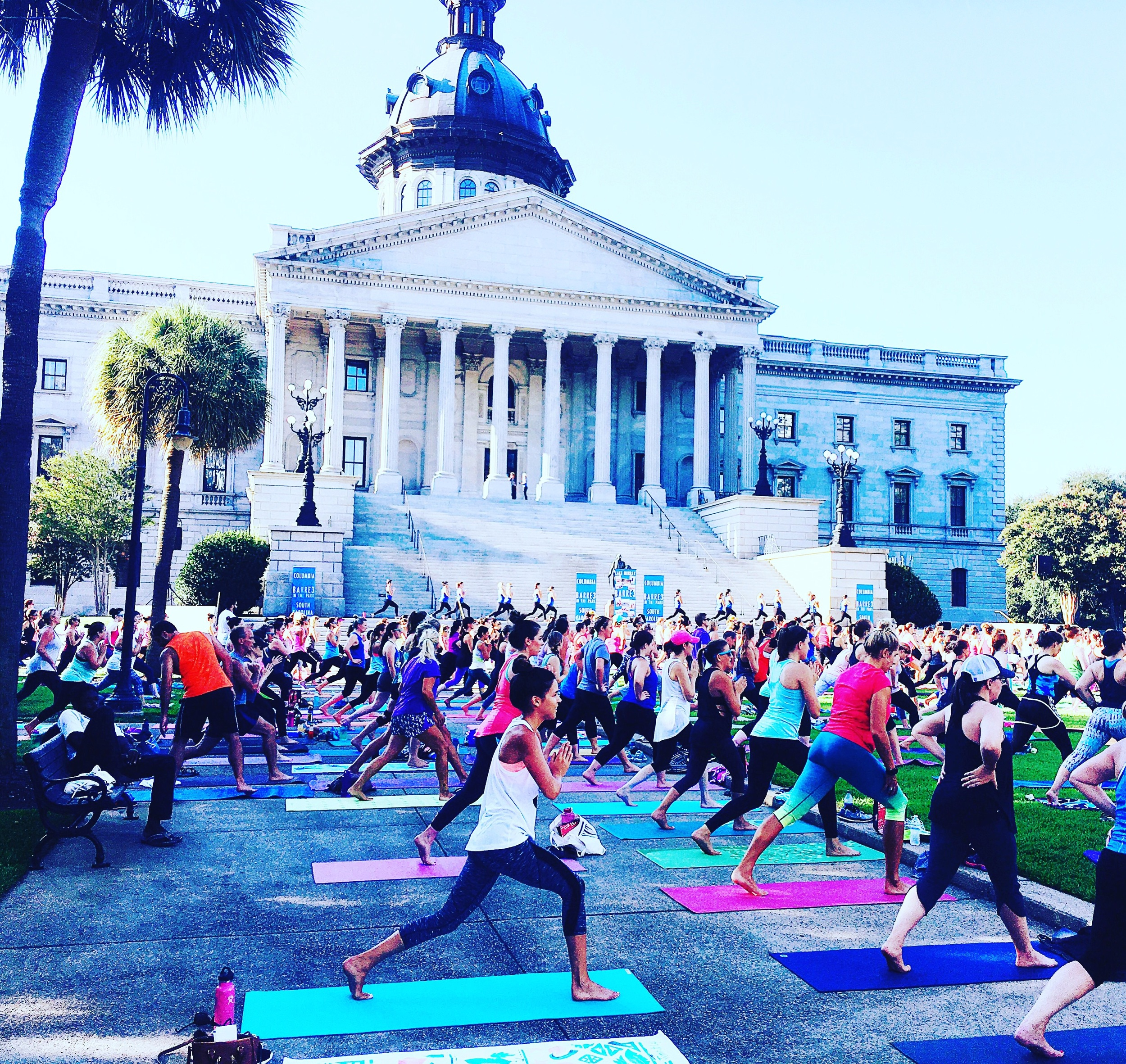 Barre3 in the park class in front of the South Carolina State House