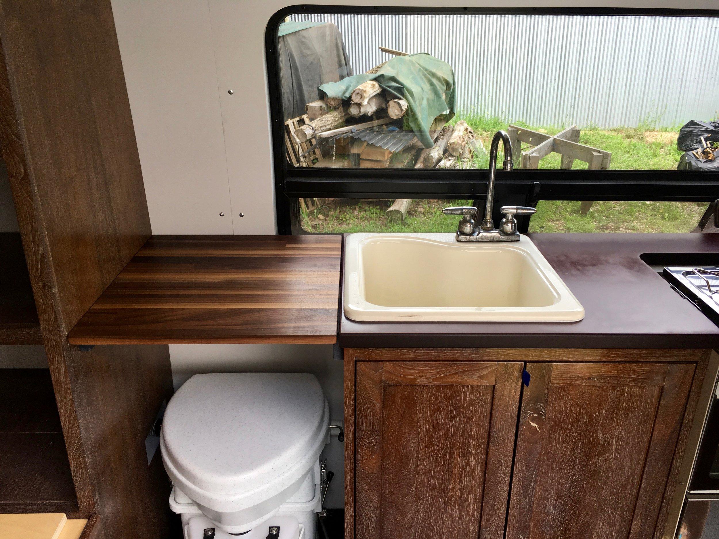 Super secret toilet under the cutting board