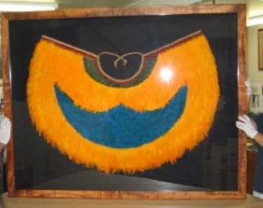 Feathered Hawaiian cloak ('Ahu 'ula)  Proprietary Koa frame, with fabric back and spacers and plexi.