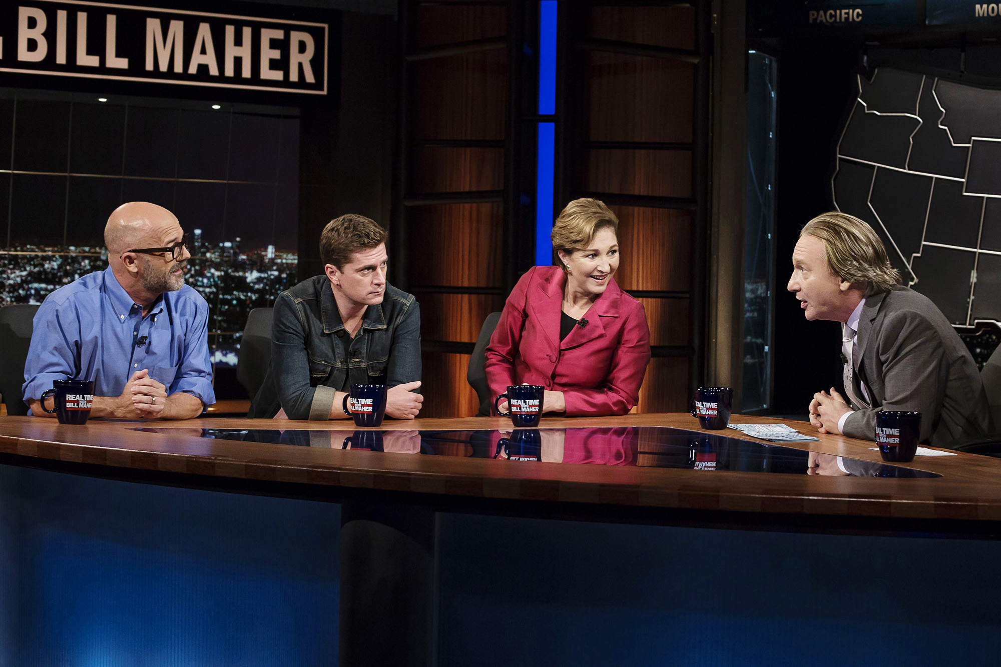 "From left: Andrew Sullivan, Rob Thomas and Anne-Marie Slaughter and Maher on his HBO talk show, ""Real Time with Bill Maher."" Photo by Janet Van Ham"