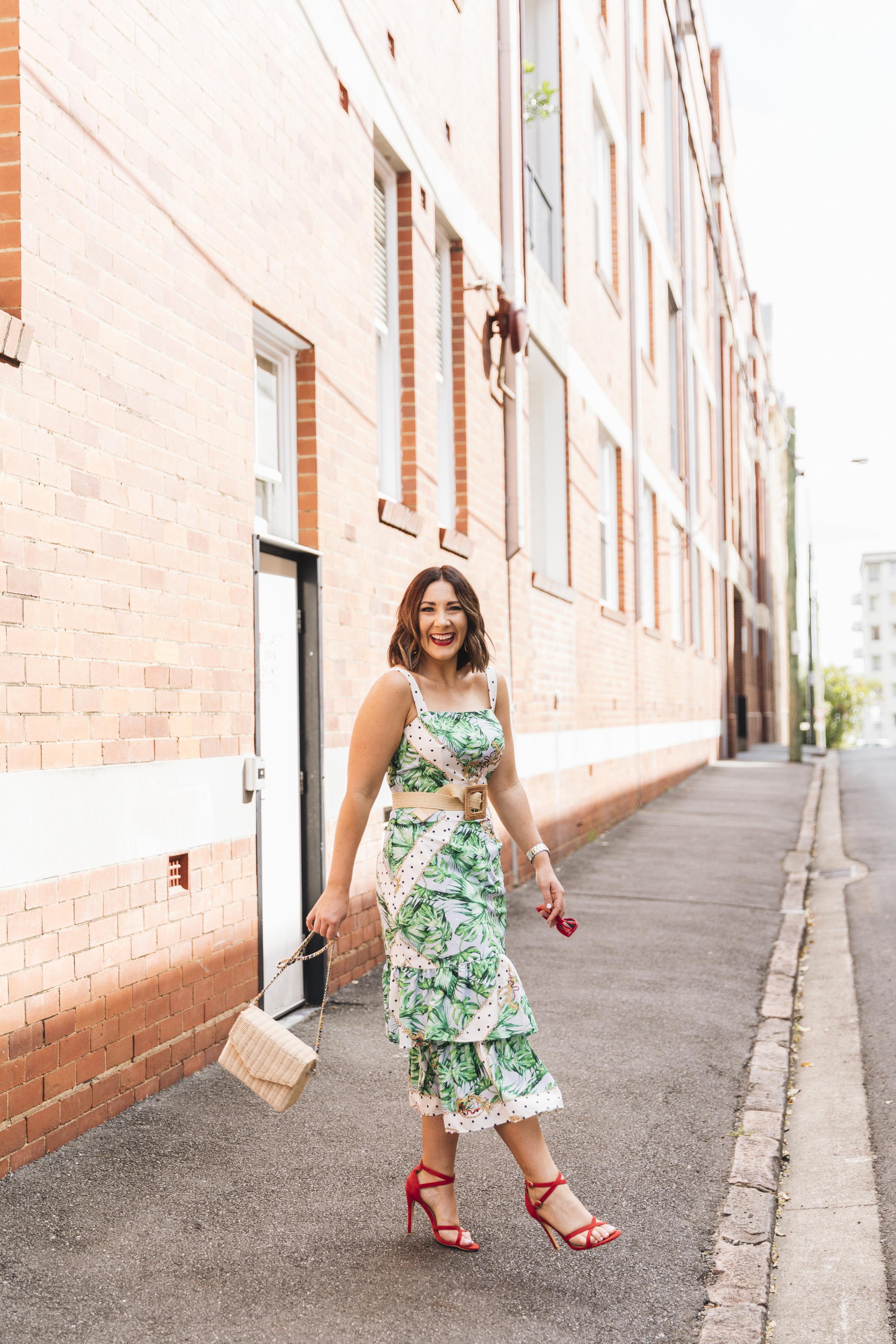 Kerrie wearing a custom Milva Carucci Designs dress.