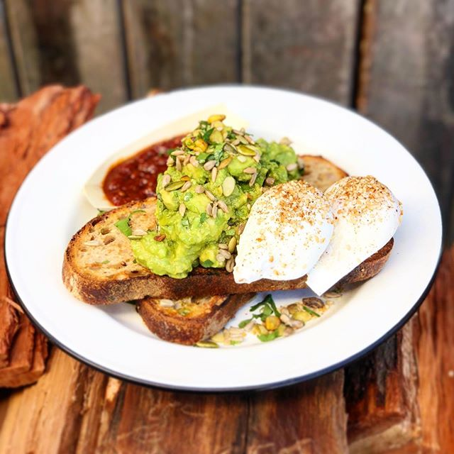 RUSTIC AVO🥑 || Our very own wood-fired, 7-grain, sourdough toast, piled high with fresh avocado, topped with toasty wholesome pistachios, sunflower seeds & pepitas, dressed with lemon juice, Joseph Olive oil, fresh parsley & voilà, you're living the Vegan dream 😍... Orrrrrr grab it with a couple of perfect poachies, Chilli Sambal & Bacon🥓 because who needs a mortgage anyway💁🏼‍♀️?!