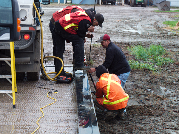 """Soil stabilization contractors using 14"""" long soil probe to inject Prime Resins """"Prime Flex 920"""" grout into the ground and create permanent solid base for the weigh scale pillars."""