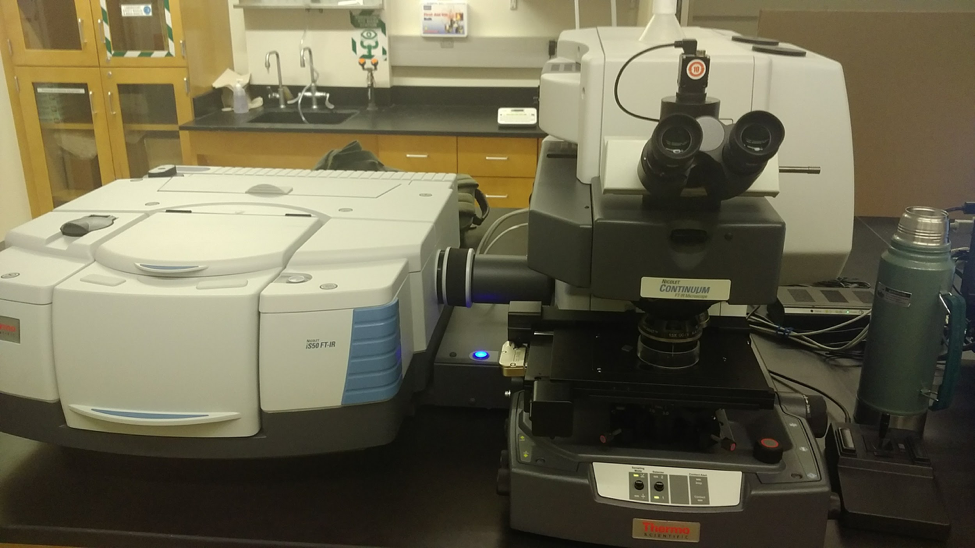 """*The FTIR. On the left is the first """"chamber"""" and on the right the second """"chamber"""" I talked about. The green thermos on the right is used to pour liquid nitrogen into the second chamber."""