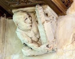 Sculpture of Cass Gilbert holding the Woolworth building found in the lobby