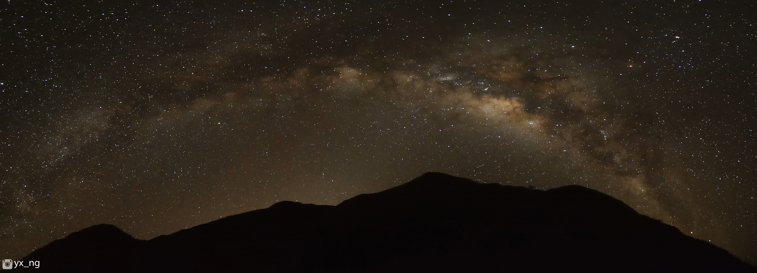 Blessed to see Milky Way in horizontal. I attempted my first night panorama. 9 shots merged using PS Photomerge. F/2.8 15 Sec ISO 6400. 11mm Tokina Nikon D7100.