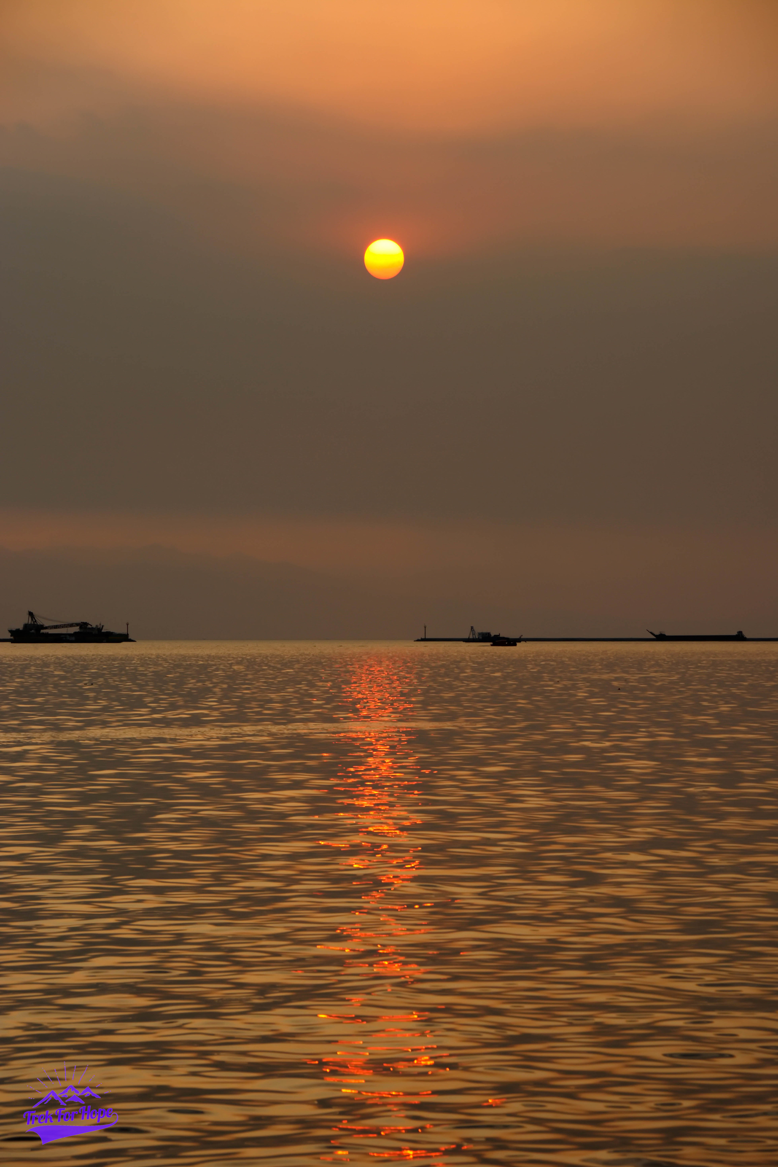 Sunset. Manila Bay. Beautiful place. But with trash. Our trash. Litter everywhere...