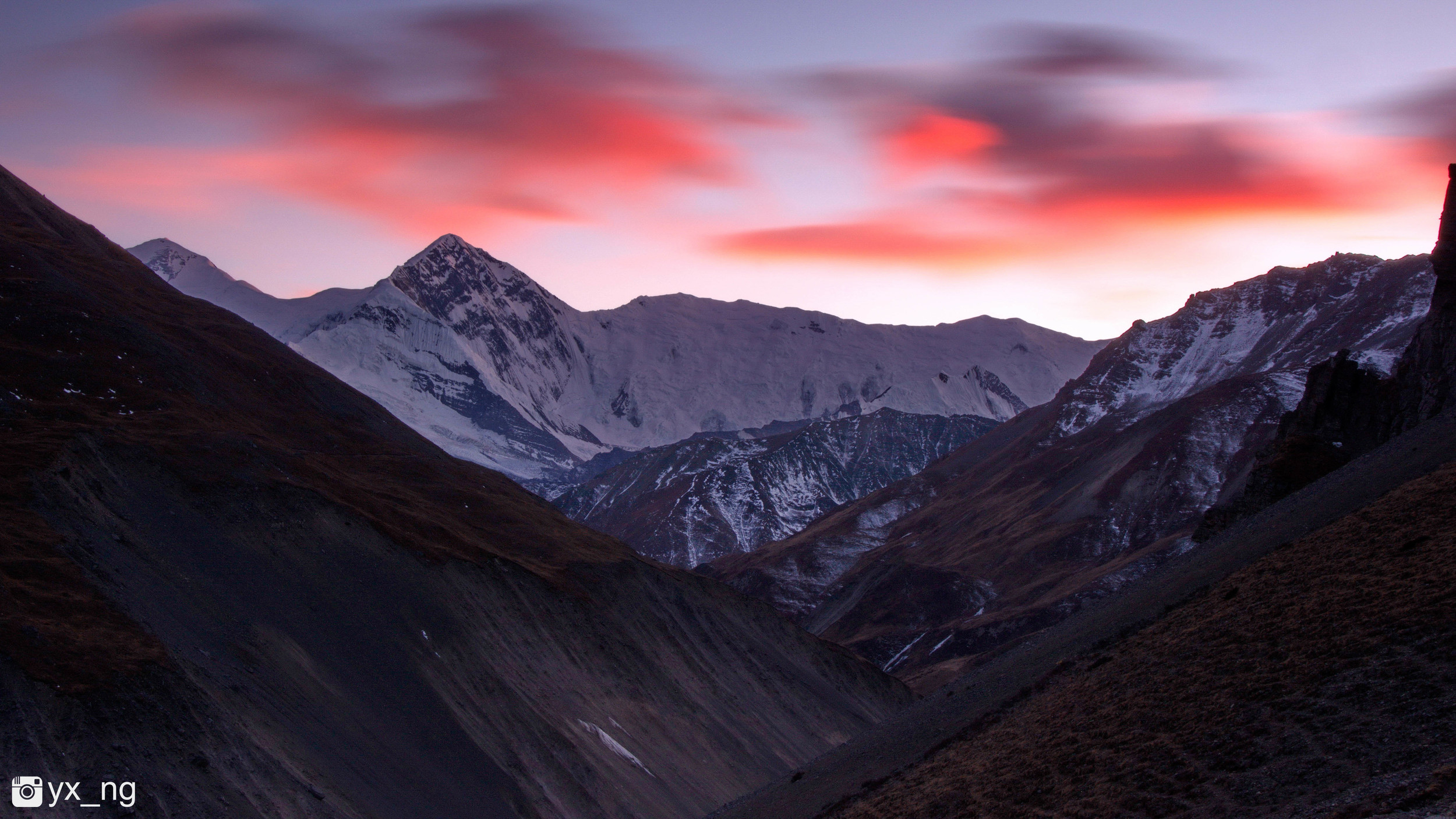 Closing into 5,000m. Sunset red. Long exposure.
