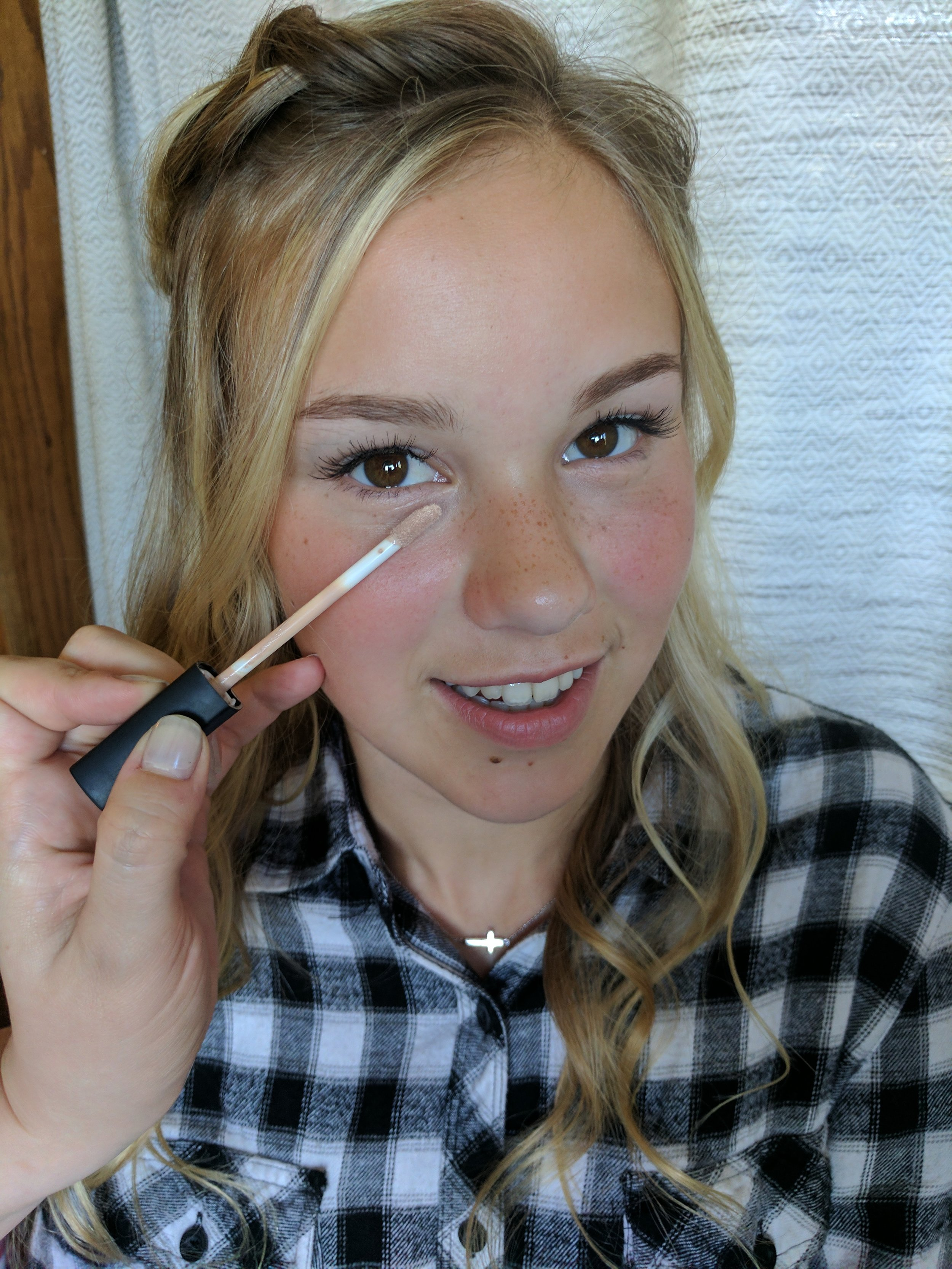 Step 3. - Apply concealer to any trouble spots and gently blend (I just use my *clean* fingers!)