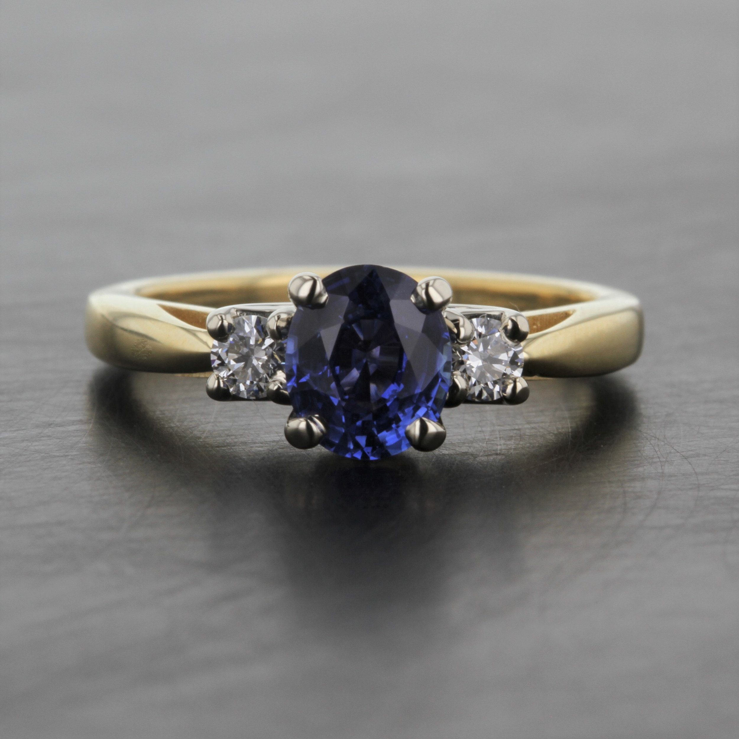 oval-natural-blue-sapphire-three-stone-diamond-accent-18K-yellow-gold-custom-ring.jpg