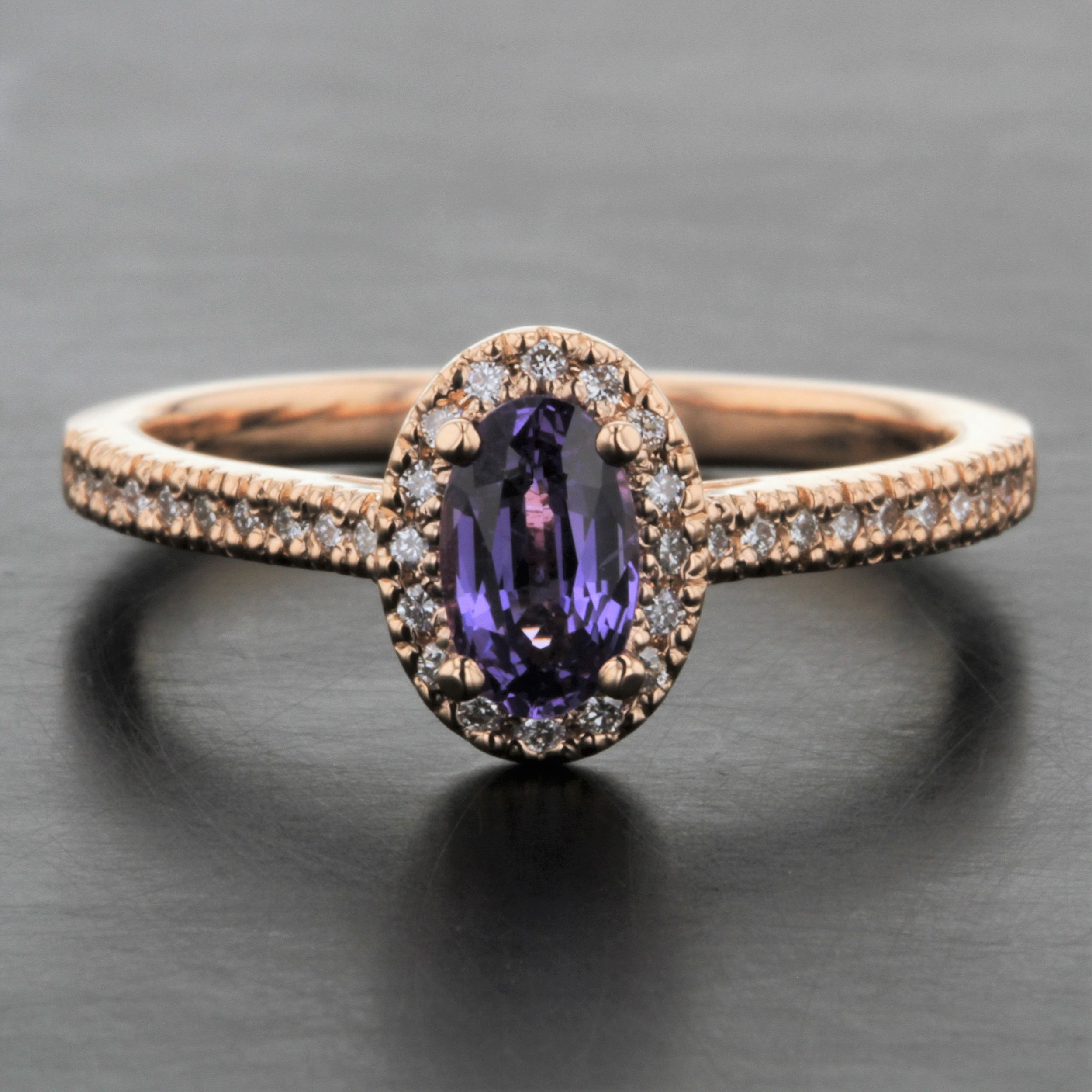 purple-oval-sapphire-rose-gold-halo-diamond-engagement-ring.jpg