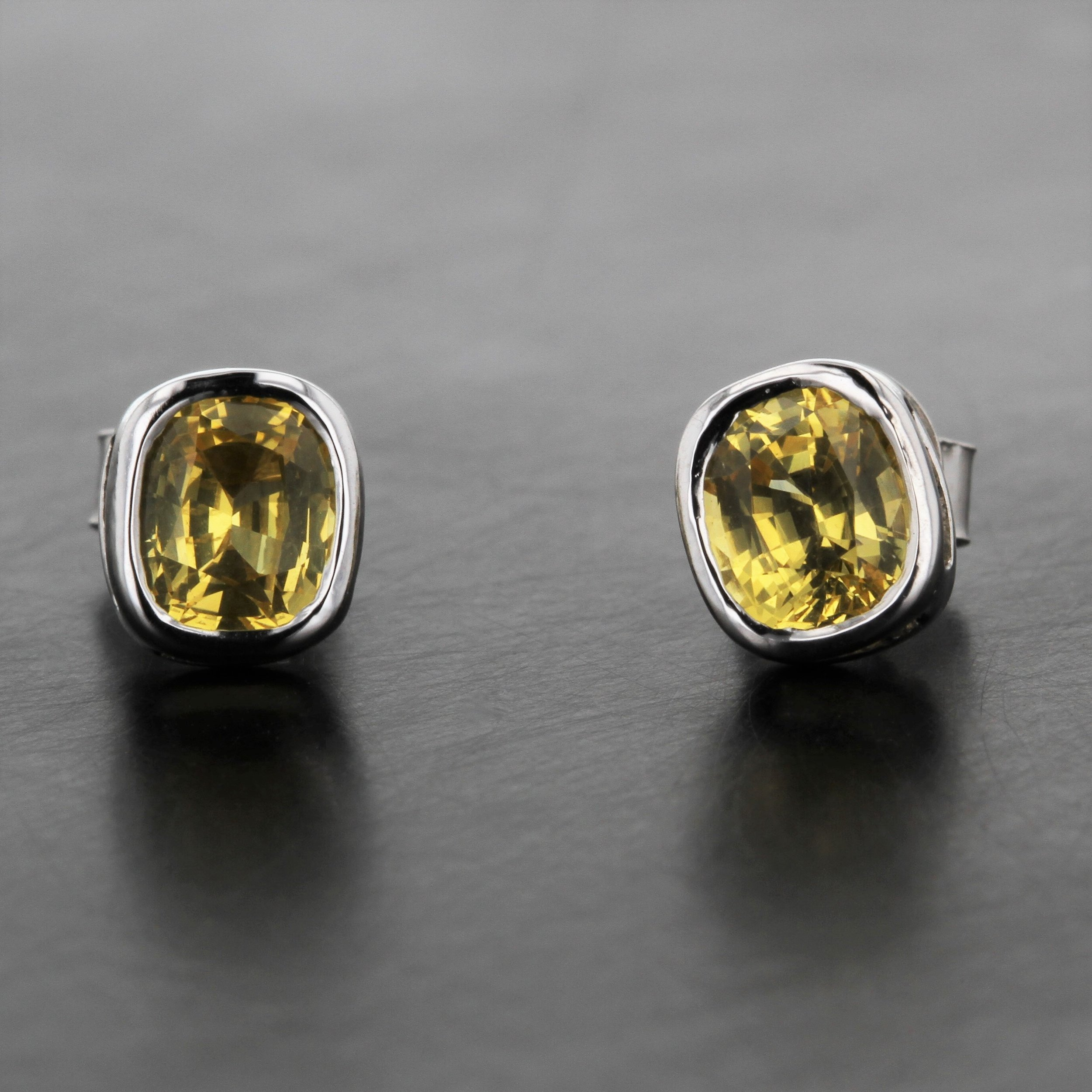 yellow-cushion-cut-sapphire-white-gold-bezel-set-custom-stud-earrings.jpg
