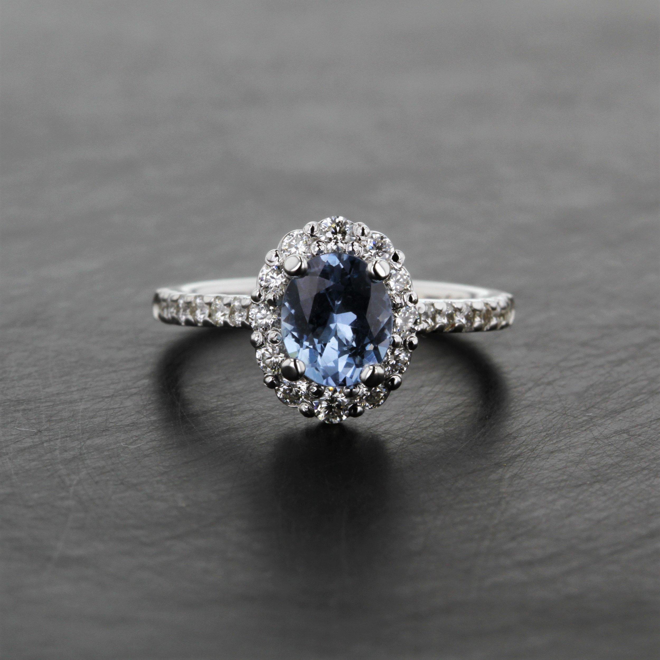 custom-light-blue-sapphire-halo-ring.jpg