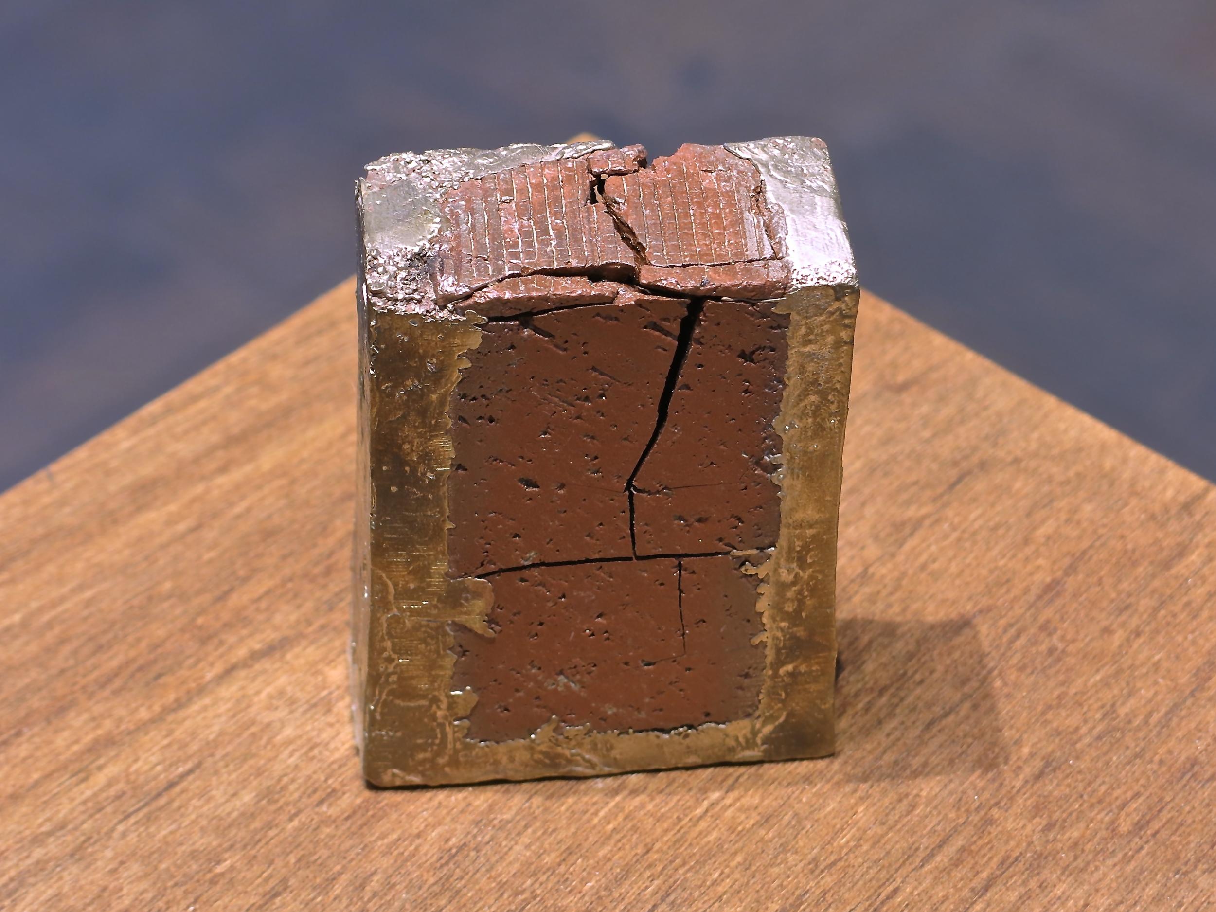 "Broken #3 | H. 2.5"" W. 2.5"" D. 1"" | Bronze and found object | Year 2014 | Photo: Mazdak Shadkam"