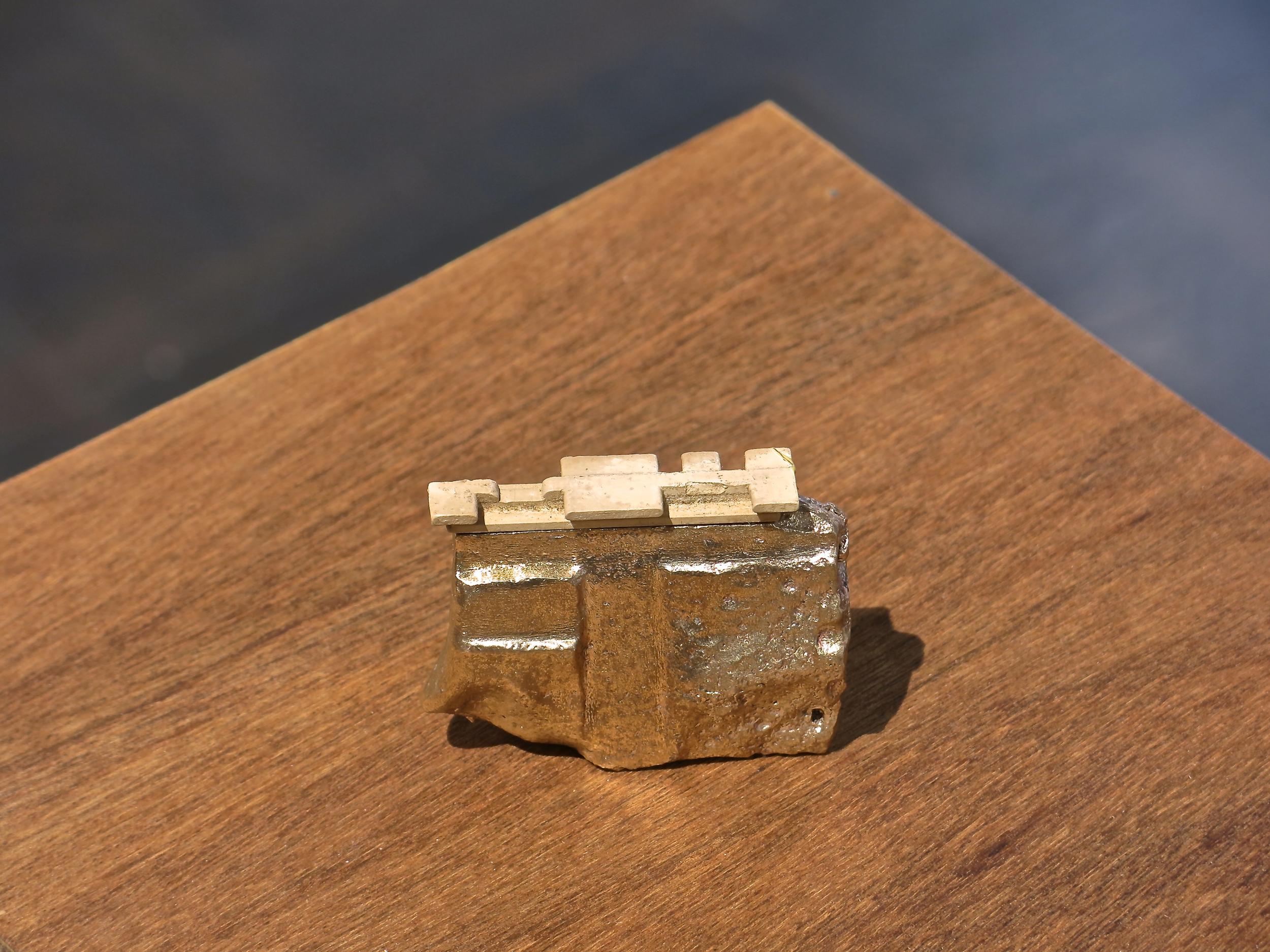 "Broken #8 | H. 2.5"" W. 2.5"" D. 1"" | Bronze and found object | Year 2014 | Photo: Mazdak Shadkam"