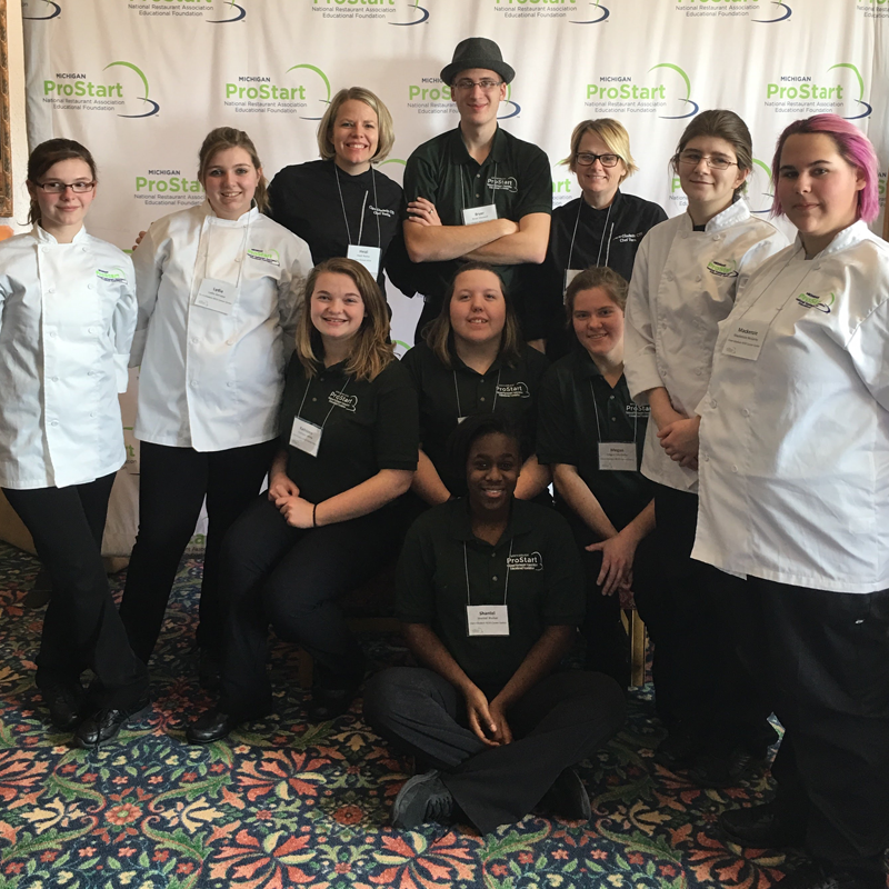 Culinary Arts students represented Clare-Gladwin CTE very well at the Michigan ProStart competition in March. Pictured are (standing) Harley Hakes, Lydia Gervase, Instructor Heidi Rocha, Bryer Maxwell, Paraeducator Tara Dutcher, Kathy Schimansky and Mackenzie McGarey; (sitting) Kathleen White, Megan Hadley and Megan Marhofer; and (kneeling) Shantel Walker.