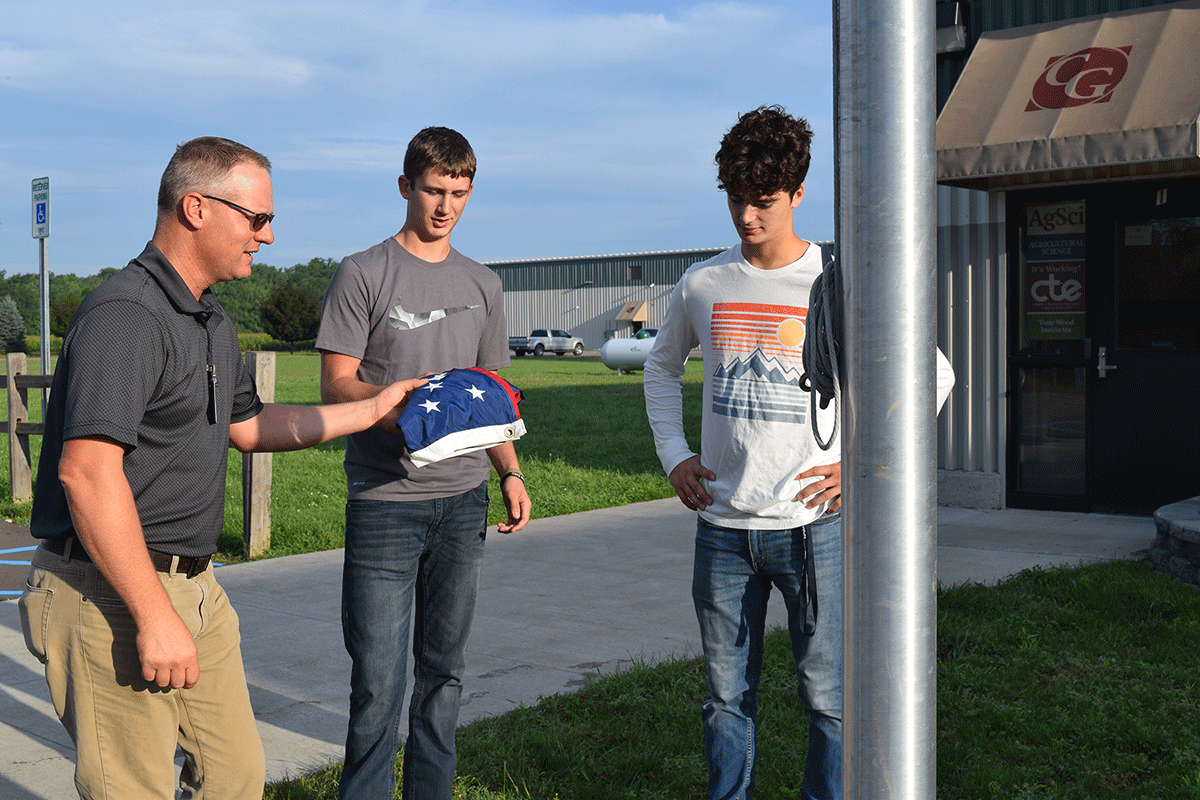 Each morning, Ag-Science students are given the responsibility of hanging the American flag. At the end of the day, their neighbors in CTE's Health Occupations class remove it.