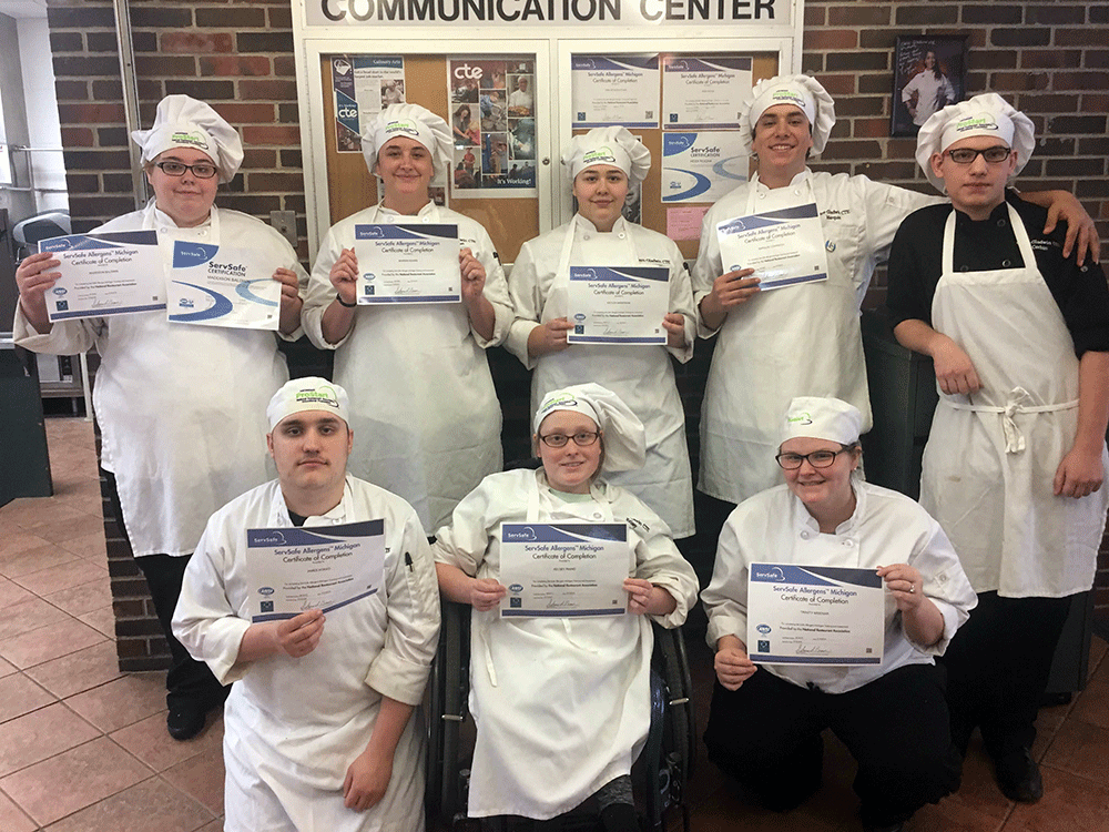 PM class - ServSafe Allergens Certificate  Back row left to right - Maddison Baldwin (HHS senior), Mariah Adams (HHS senior), Kaylea Anderson (HHS senior), Marquis Czarnecki (HHS senior), & Corbin Burrous (FHS senior)  Front row left to right - James Kokkos (HHS senior), Kelsey Rhind (GHS senior), & Trinity Misenar (HHS senior)
