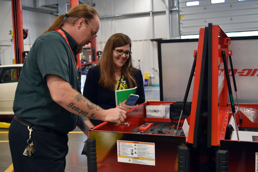 CTE Auto Tech Instructor Don Maurer shows off some new Snap-On equipment to Jennifer Geno, Saginaw's CTE Director.