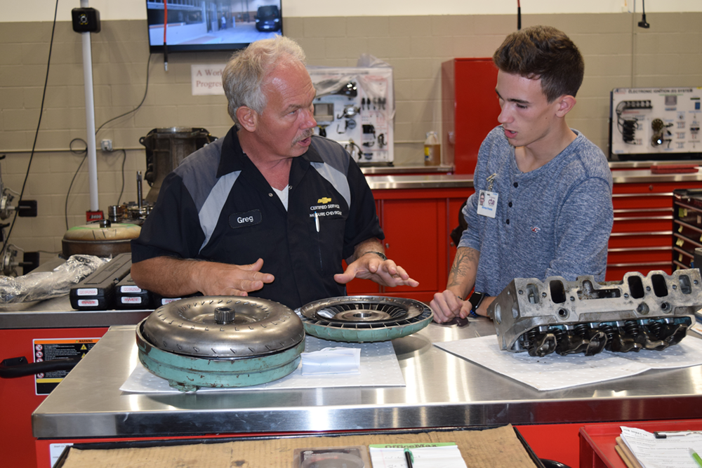 Greg Neckel from McGuire Chevrolet discusses torque converter design and operation with student host Atreyu Franks at the open house.