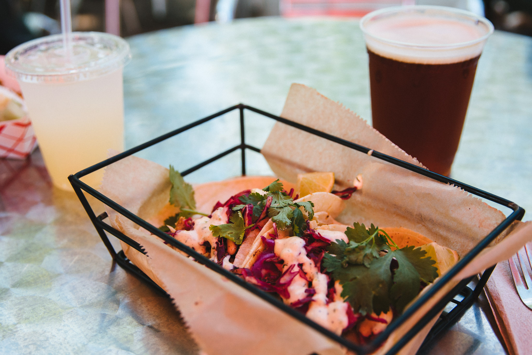 Beat the summer heat with some fish tacos, a cold brewski, and an ice-cold lemonade.  Dog Flicker - beef dog with kimchee, dried egg and cilantro and cheese curds on side