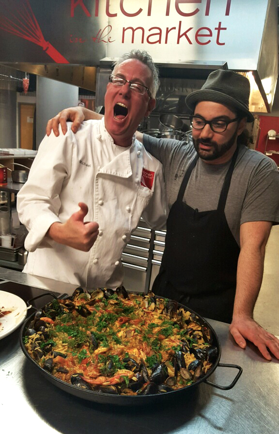 Kitchen in the Market 's Head Chef Michael Lamon (left) with  World Street Kitchen and  Milkjam Creamery owner Sameh Wadi are excited to eat some paella. Photo by Urmila Ramakrishnan