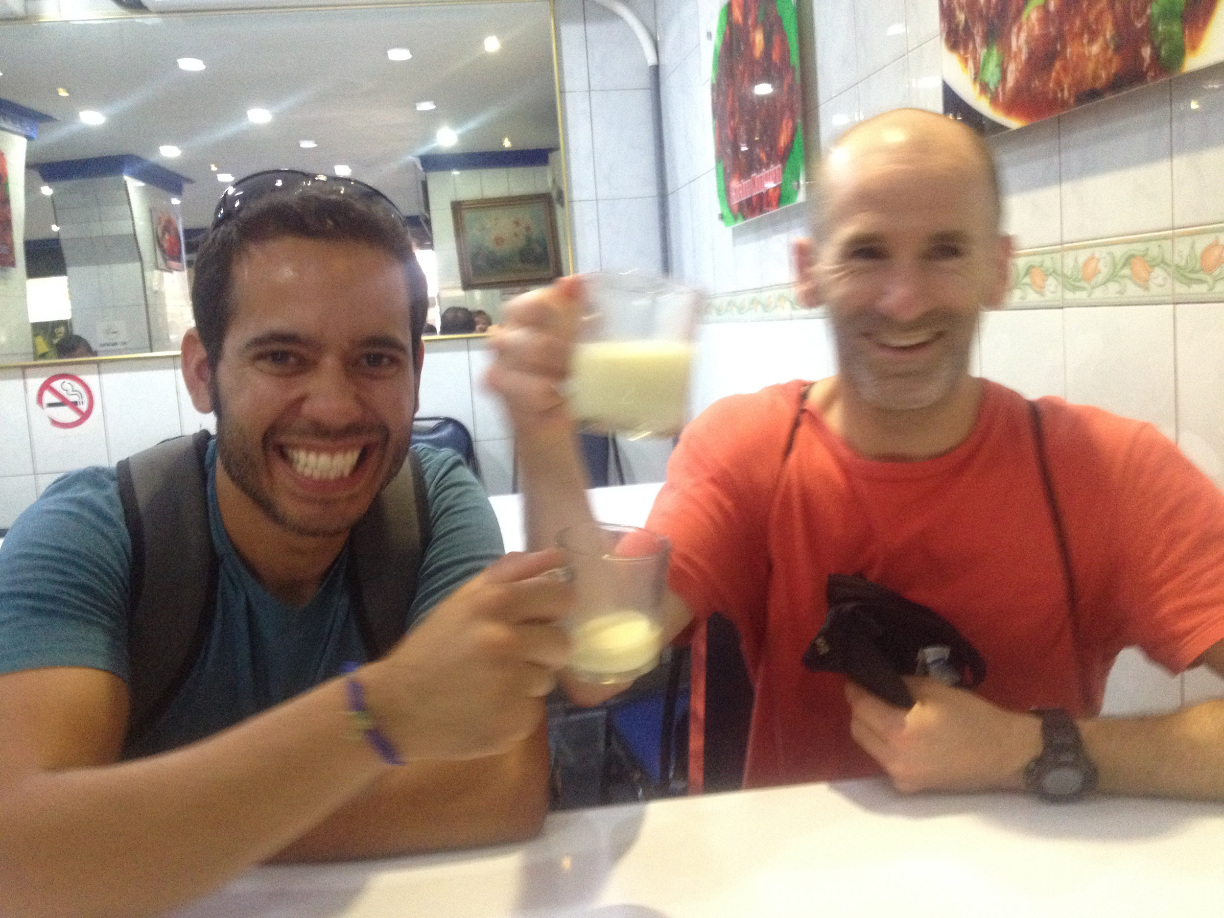 ENJOYING THEIR INDIAN DRINK, BADAM.