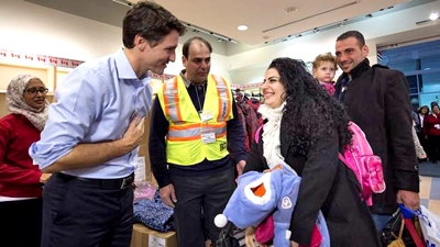 Justin w refugees.jpg