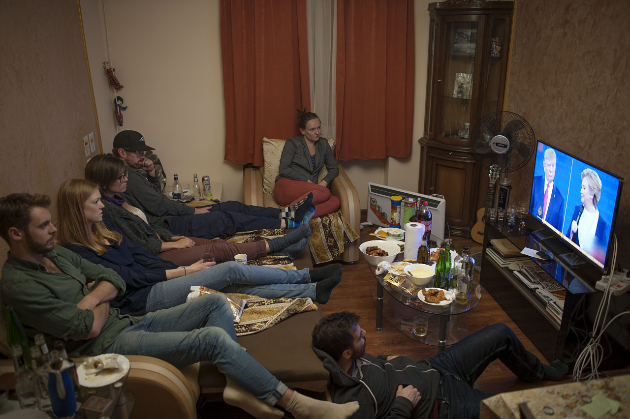Friends gathered at Alyssa and Greg's apartment, an #American couple, for a U.S. Presidential Election watch party on November 9, 2016 in #Armenia. Photo by @nazikarmenakyan.