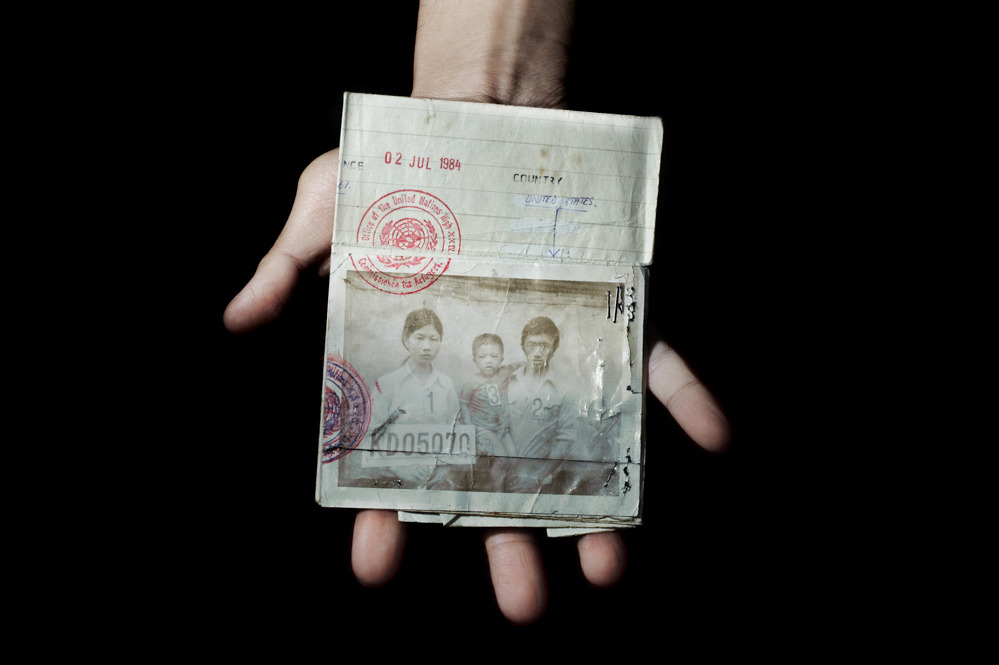 Sunny Vaahn, 25, a graduate of Carnegie Mellon, holds the refugee identification card of his family members. The photograph was taken upon their initial entry into a refugee camp after their arduous trek across the Thai border following the end of Khmer Rouge rule in Cambodia. The family made the trek because they were told that there was food on the other side of the border. © Pete Pin, 2011 MF Fellow.