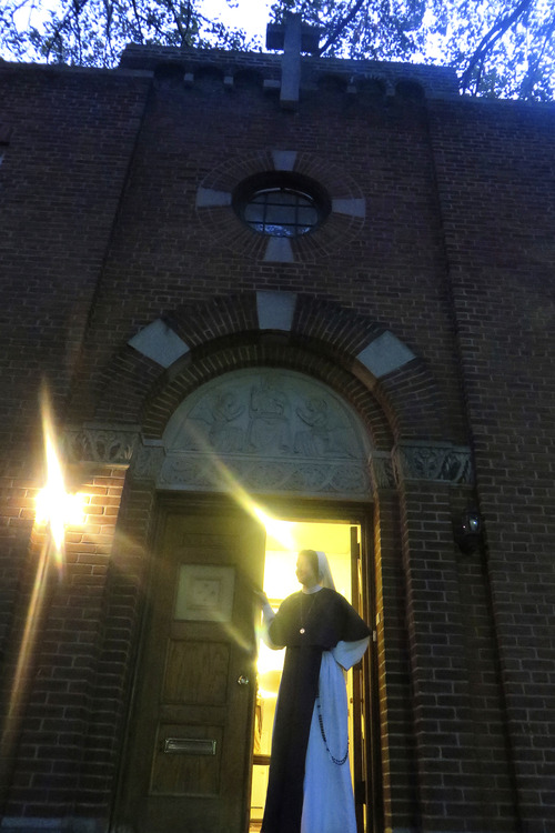 Sister Catherine, stands in the door way of the Sisters Of Life Convent in Hell's Kitchen.