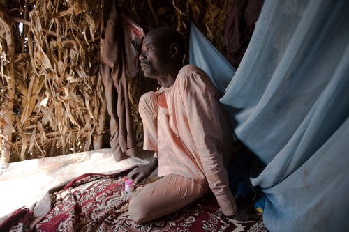 """""""When Boko Haram came to Gwoza they were killing everybody. I escaped at night. I counted over ten dead bodies as I was escaping. Twelve members of my family are missing. I don't know where they are. I'm alone. Now I have nothing. Even food is hard to come by. All my thoughts are on home and returning home."""" Ahmadu, 46, is a farmer who has been living in Daware settlement in Fufore, Adamawa state for the last four months. Daware is a sprawling shanty settlement of over 3,000 displaced persons who have built homes out of old sacks and dried stalks. Over the months they have managed to farm the land growing crops to sell at the market for subsistence. Still life is hard as there is a severe lack of water and food. 2014, © Rahima Gambo"""