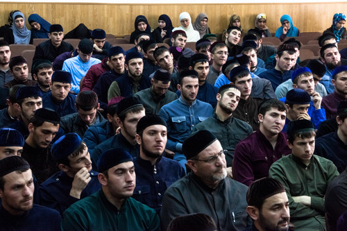 Students of the Islamic University in Grozny (men in the front, women in the back) listen to a lecture by a guest mullah from Jordan.Grozny, Chechnya, Russia, 2013