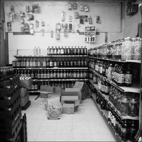Section of the unrefrigerated soda selection, corner store, Auburn Gresham, South Side, Chicago, 2011.