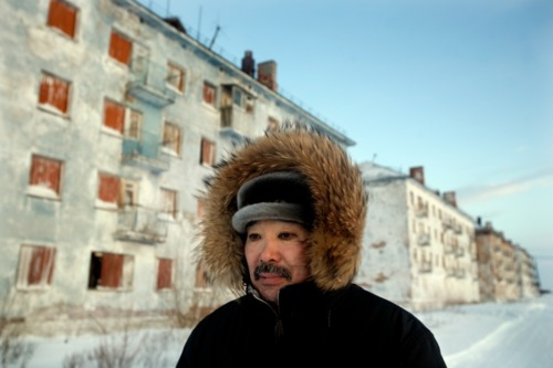 Karp Belgayev, a coal miner, walks through Yor Shor, an abandoned village near Vorkuta where he is among the last ten inhabitants. Miners say that after ten years working underground it is impossible to remove black rings from around the eyes.